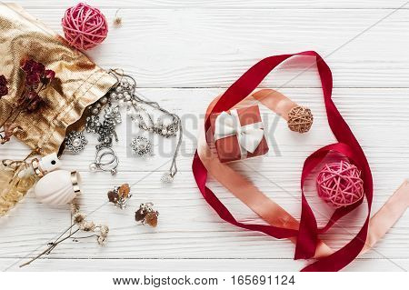Stylish Red Present And Luxury Jewelry  Accessories On White Rustic Wooden Background. Happy Valenti