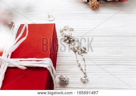 Luxury Expensive Jewelry And Stylish Red Present On White Rustic Wooden Background. Happy Valentine