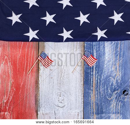 Flag of the United States of America on rustic painted boards in national colors.