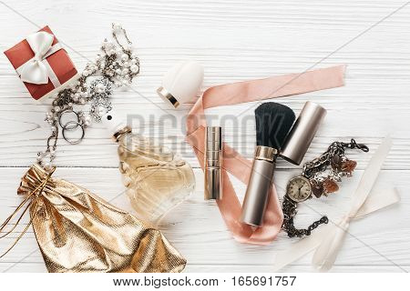 Fashion Blogger. Luxury Make Up Essentials Brush And Lipstick And Jewelry Perfume Flat Lay On White