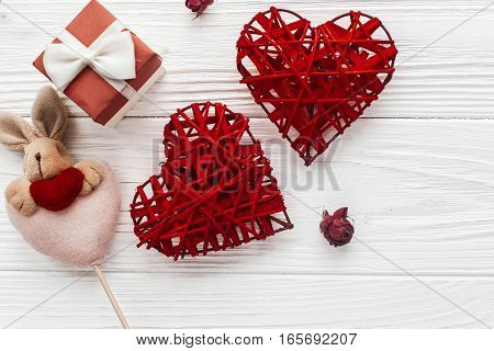 Stylish Hearts And Bunny Toy And Gift Box On White Wooden Background. Happy Valentines Day Concept.