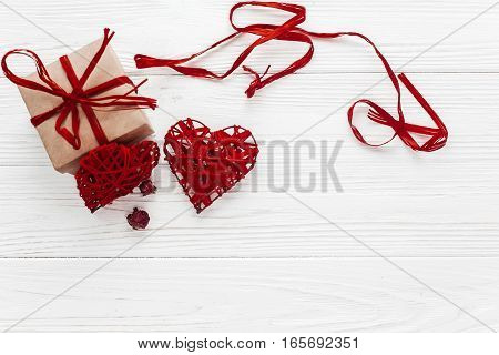 Valentine Day Concept. Stylish Craft Present Box And Hearts Roses Flat Lay On White Wooden Backgroun