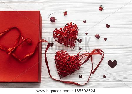 Valentine Day Concept. Stylish Present Box And Hearts Roses Flat Lay On White Wooden Background. Hap