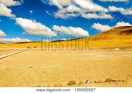 Yellow landscape near San Pedro de Atacama Chile with a beautiful blue sky