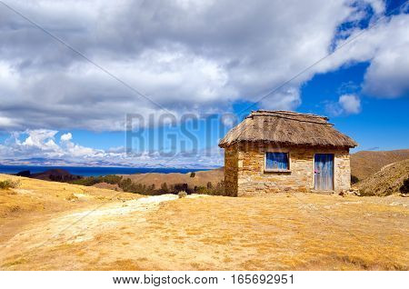 Small hut on the Island of the Sun with Lake Titicaca in the background in Bolivia