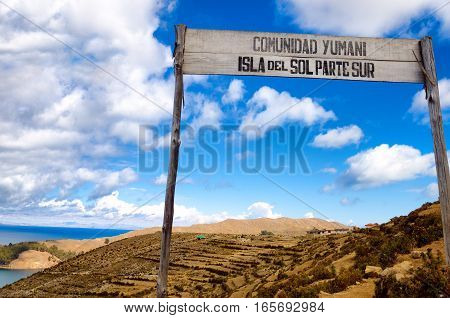 Sign announcing the arrival to the Yumani Community in the south part of the Island of the Sun in Bolivia
