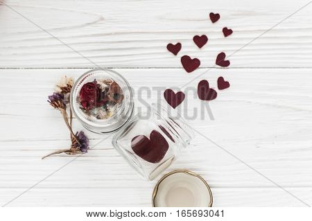 Stylish Hearts In Glass Jar And Roses On White Wooden Background. Unusual Happy Valentines Day Conce