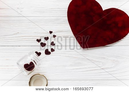 Valentine Concept. Stylish Velvet Heart And Glass Jar On White Wooden Background Flat Lay. Happy Val