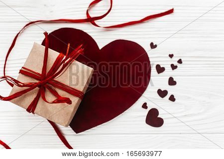 Stylish Present Box And Hearts Flat Lay On White Wooden Background. Happy Valentines Day Concept. Gr