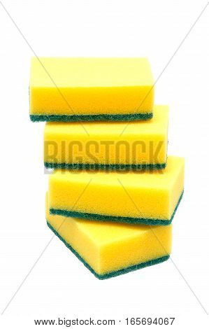 Four kitchen sponges for washing dishes isolated on white background
