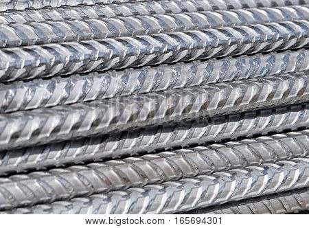 Division rebar made of steel, used as armature in building industry. Those metal rods reinforce concrete constructions.