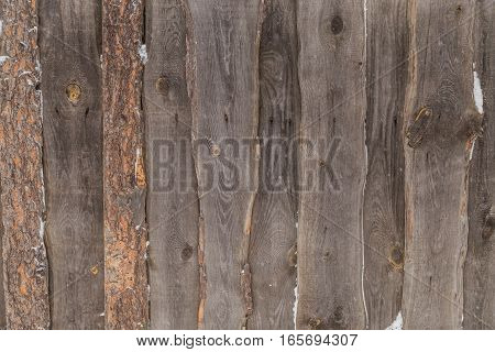 old wooden background in the street in winter