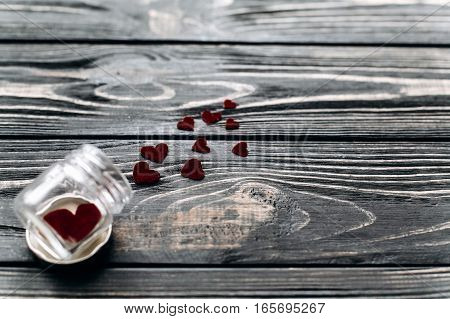Valentine Concept. Stylish Velvet Hearts In Glass Jar On Black Rustic Wooden Background. Happy Valen