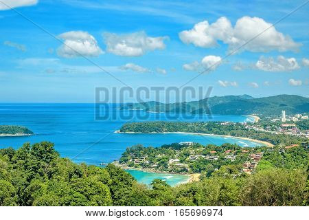 Landscape with turquoise sea beaches tropical greenery on the background of blue sky with white clouds. The view from the observation platform of the island of Phuket Thailand