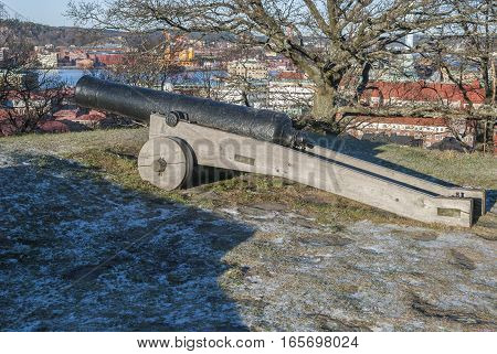 Old cannon with Gothenburg in background, travel Sweden