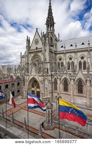 flags by the basilica de voto nacional Quito a neo-gothic style architecture