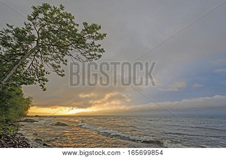 Sun Peeking Through the Clouds on the Lakeshore of Lake Superior in Porcupine Mountains State Park in Michigan