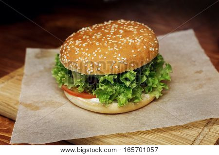 Yummy Burger. Serving Cheeseburger Or Hamburger With Salad And Tomatoes On Wooden Desk. Catering In