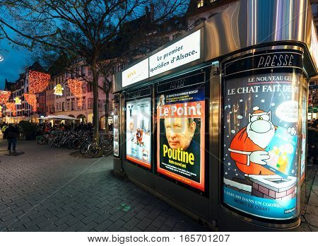 STRASBOURG FRANCE - DEC 06 2015: Press kiosk with Vladimir Putin face on he Le Point magazin and headline: Putin is our friend