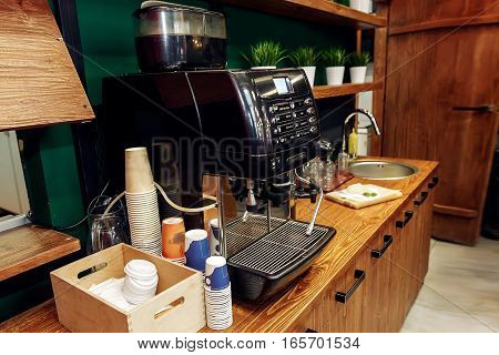 Stylish Coffee Machine And Paper Cups On Wooden Desk. Take To Go. Catering In Food Court At Mall Con