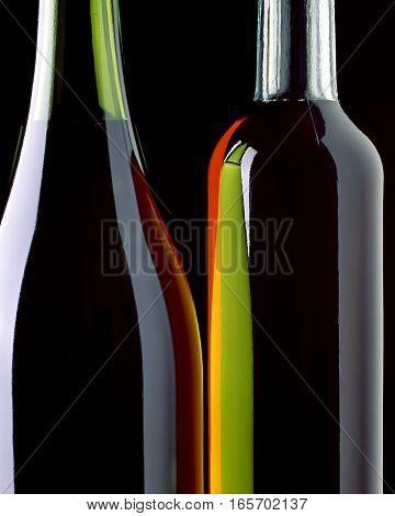 The light of reflector displays in dark-green glass of bottle. Color: black, orange, green.
