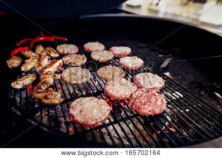 Pork Meat And Chicken Cutlets With Pepper Grilling For Burgers. Catering In Food Court At Mall Conce