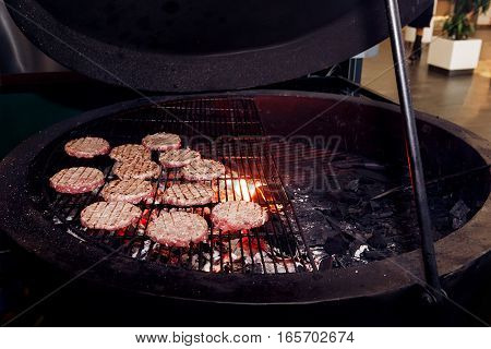 Meat Cutlets Grilling For Burgers. Catering In Food Court At Mall Concept. Space For Text. Stylish M