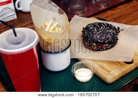 Yummy Burger. Serving Cheeseburger Or Hamburger With Cola And French Fries On Wooden Desk. Catering