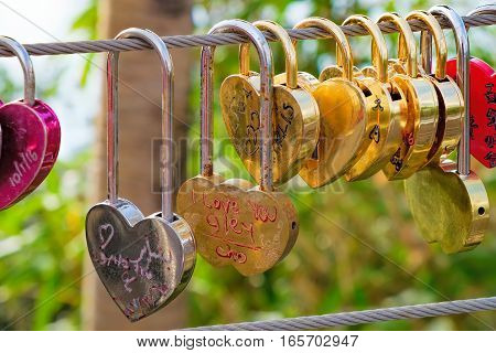 Langkawi, Malaysia - February 16, 2016: Love padlocks at Langkawi SkyCab Cable Car. Locks of love is a custom in some cultures which symbolize their love will be locked forever.
