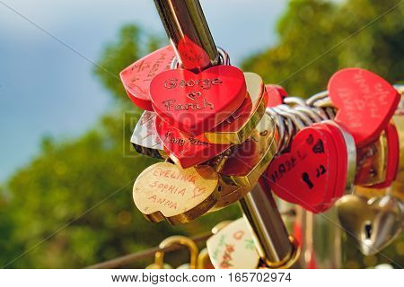 Langkawi, Malaysia - February 16, 2016: Love padlocks at Langkawi SkyCab, Cable Car. Locks of love is a custom in some cultures which symbolize their love will be locked forever.