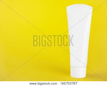 white plastic tube without labels containers for cream or toothpaste