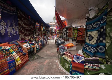 the artisan market in the Plaza de Ponchos in Otavalo Ecuador