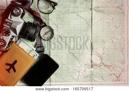 Wanderlust And Adventure Concept, Old Compass Watch Photo Camera Passport And Money Lying On Map, To