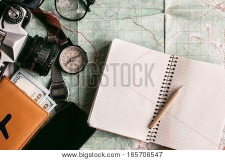 Wanderlust And Adventure Concept, Compass Camera Phone  Passport Money Notebook Lying On Map, Top Vi