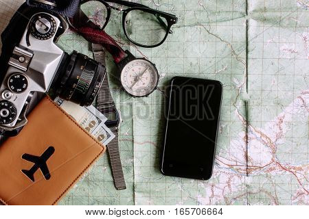 Wanderlust And Adventure Concept, Phone With Empty Screen Compass Camera Passport Money On Map, Top