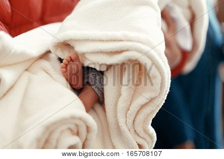 Cute Little Feet Of A Boy In Soft Comfortable Blanket At Christening Ceremony In Church In Godfather