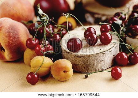 delicious cherry and fruits on wooden background rustic summer concept colorful