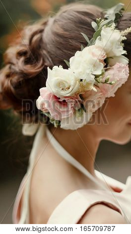 Wedding Hair Style. Luxury Pink Floral Wreath On Bride Hair  In Tender Rich Dress At Garden. Stylish