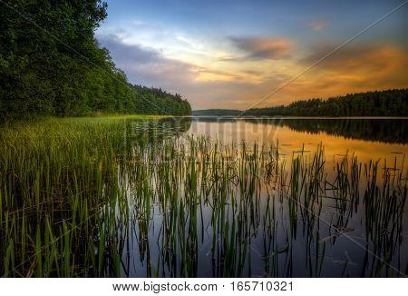 Bolesty Lake on Rospuda kayak trail on sunset Poland
