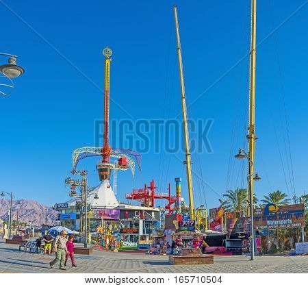 EILAT ISRAEL - FEBRUARY 23 2016: The small amusement park in the city center on promenade on February 23 in Eilat.