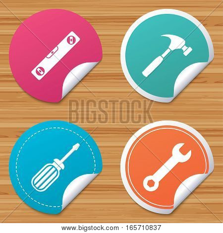 Round stickers or website banners. Screwdriver and wrench key tool icons. Bubble level and hammer sign symbols. Circle badges with bended corner. Vector