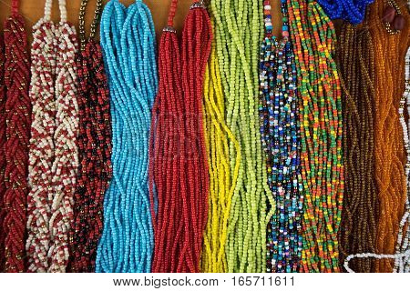 colourful microbead jewelery closeup in Ecuador Otavalo