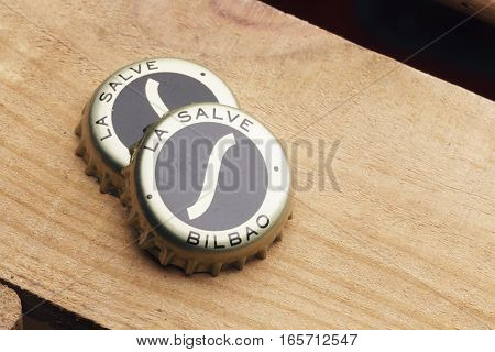 Two Bottle Caps Of La Salve Original Beer.
