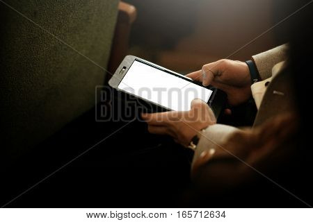 Stylish Man Holding Tablet With Empty White Screen, Sitting At Meeting, Business Marketing Lecture