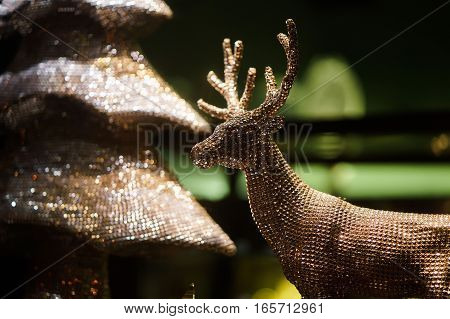 decorative gold toy Christmas deer. clouse up