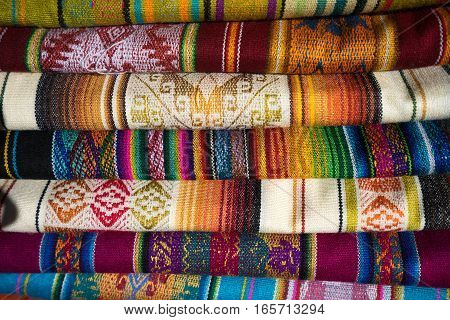 colourful textiles closeup details in the Otavalo artisan market