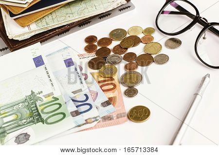 Money Pen Paper Glasses And Map On White Background, Calculating Budget, Financial Analytics Or Trav
