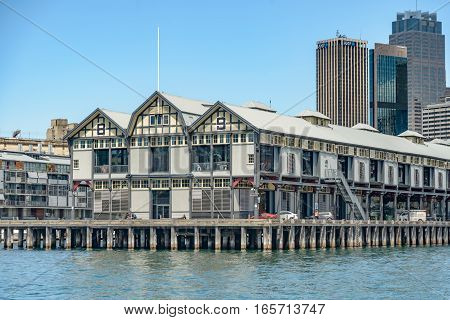 SYDNEY AUSTRALIA - OCTOBER 11 2016: Walsh Bay at Sydney Harbour. View of the wharves and Sydney skyline from a ferry on the harbour. Pier 8 and Pier 9 were originally part of Sydney's port facilities.