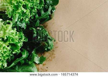 Delicious Fresh Salad Arugula Spinach  On Craft Background, Space For Text
