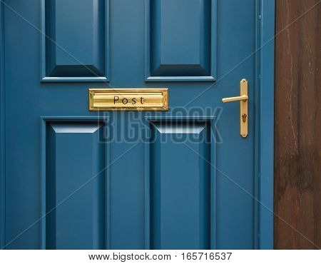 Blue modern classic door with knob or handle and post